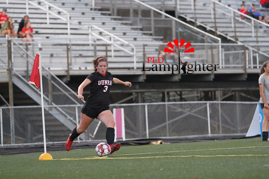 #3 Allison O'hara takes corner kick on the left side of the field.