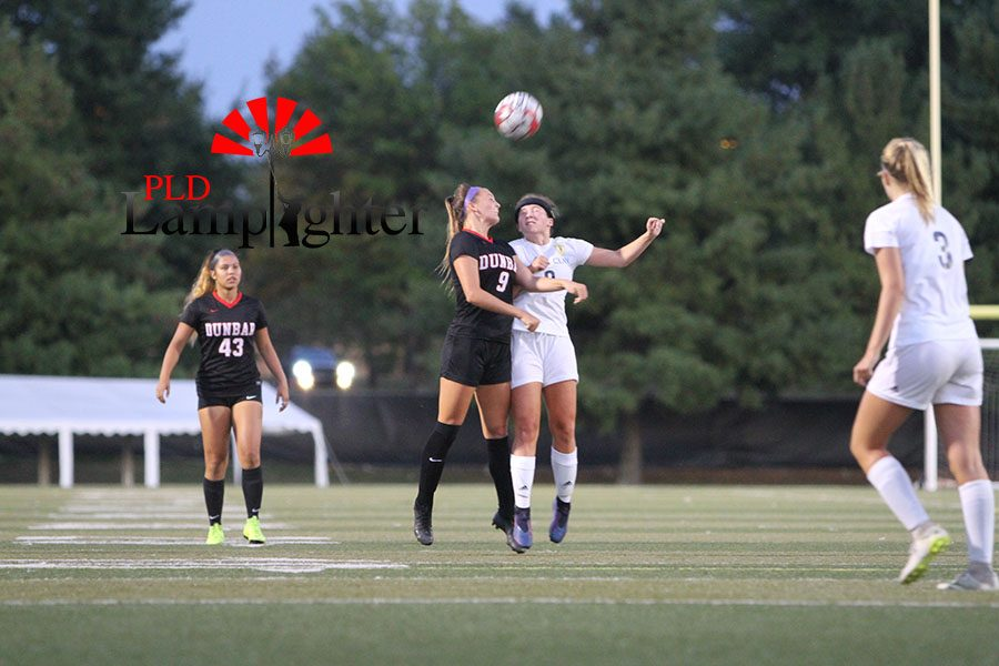 #9 Ashlyn Fuller goes up with Henry Clay defender to head the ball.