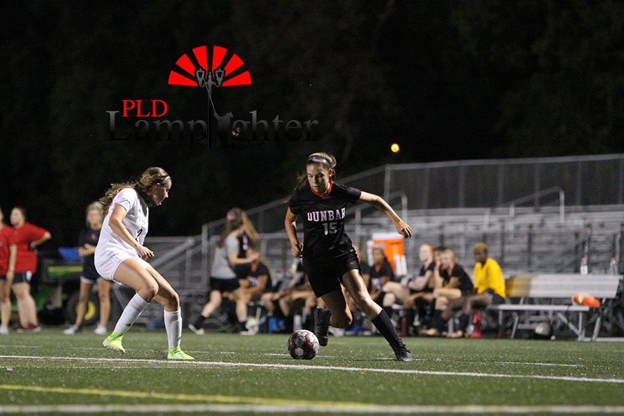#15 Isabella White rushes inside looking for a chance to score.