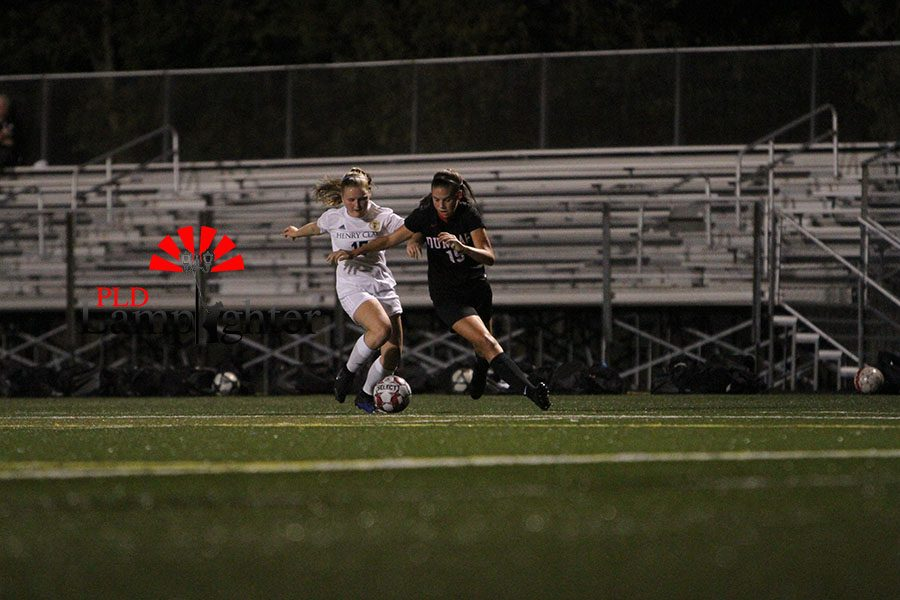 #15 Isabella White gets around a Henry Clay defender and heads to mid-field.