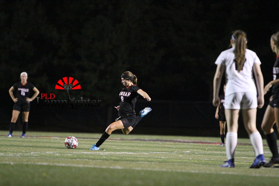 #8 Taylor Smith takes free-kick in the last few minutes of the second half.
