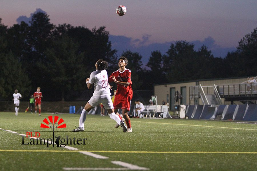 #14 Issac Cano kicks ball over his head looking to get around a Tates Creek defender.