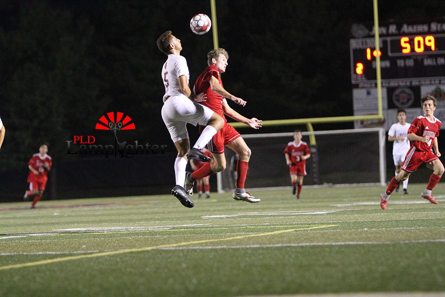 #9 Ben Oser goes up trying to head the ball to a teammate.