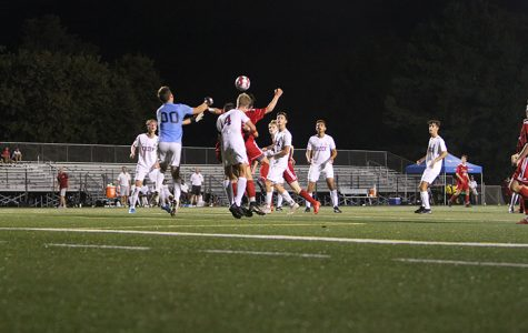 In a hard fought match, #12 Derek Burgess goes up trying to get Dunbar their second goal following a Dunbar corner kick.