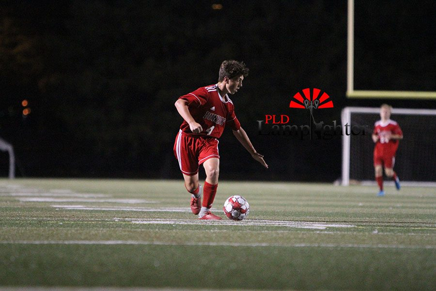 #4 Matthew Nichols rushes down the left side of the field looking for a defender.