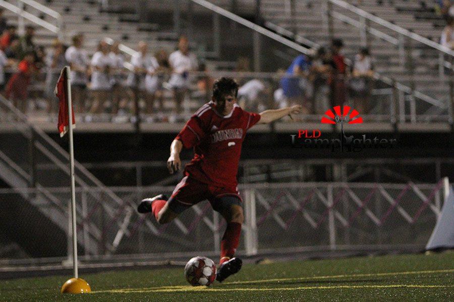 #3 Jason O'Hara takes corner kick for Dunbar.
