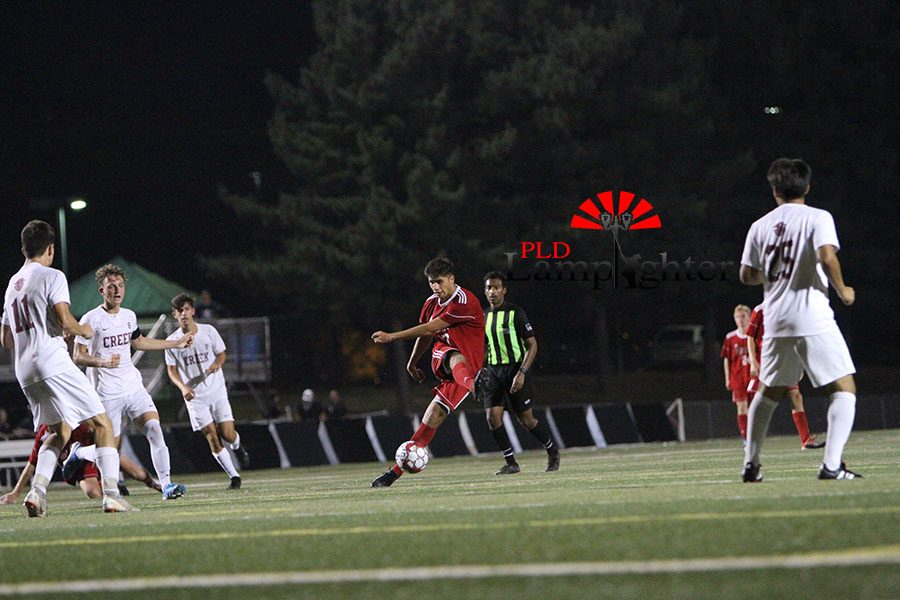 #17 Pablo Ortiz passes the ball inside to his teammate looking to spark a comeback for Dunbar.