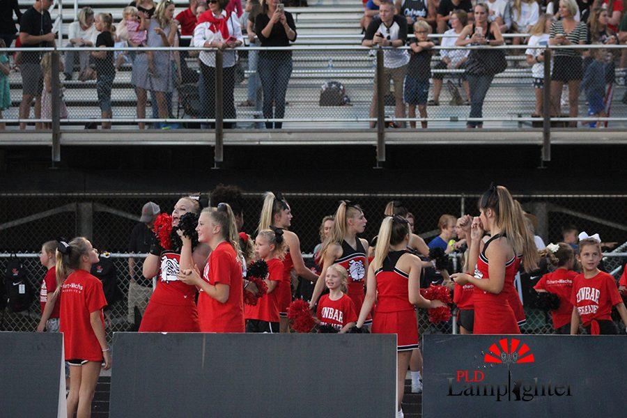 Dunbar's cheerleaders celebrate a touchdown and field goal.
