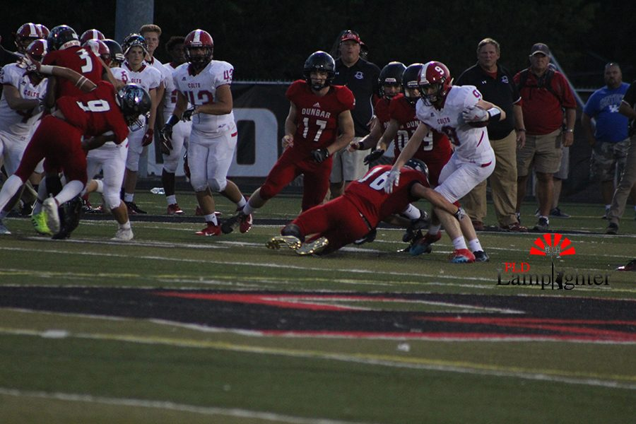 #16 Connor Smith, goes to pull down the ball carrier.
