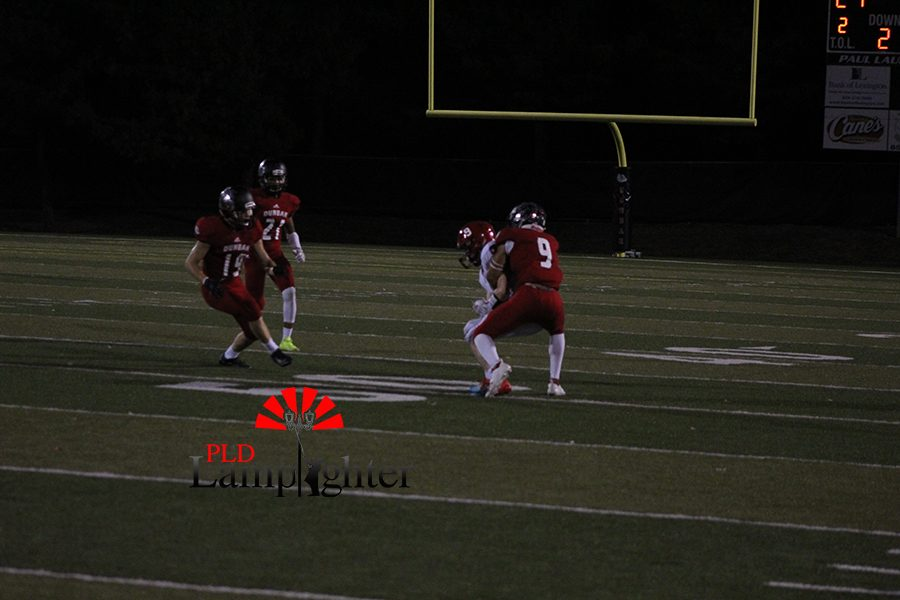 #9 Tyler Johnson, tackles the ball carrier to prevent anymore yard gain.