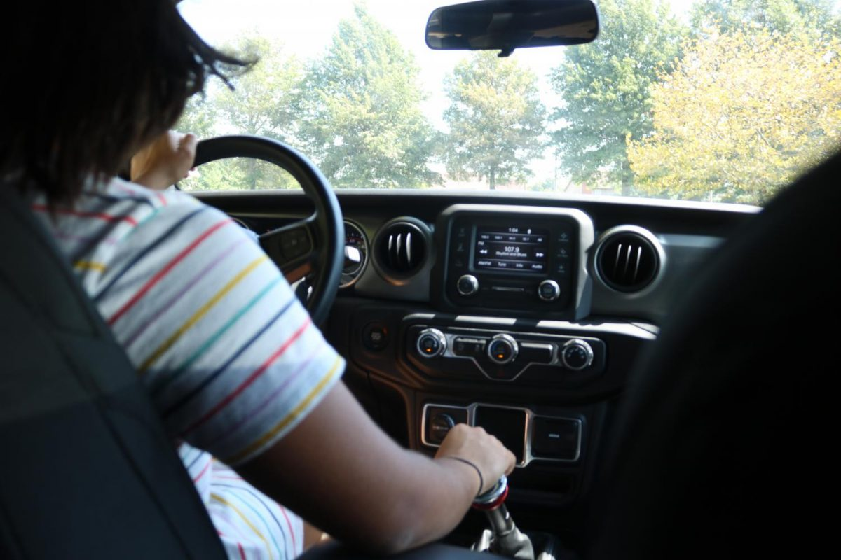 Driving her Jeep Cherokee, Camille has no problem switching gears.