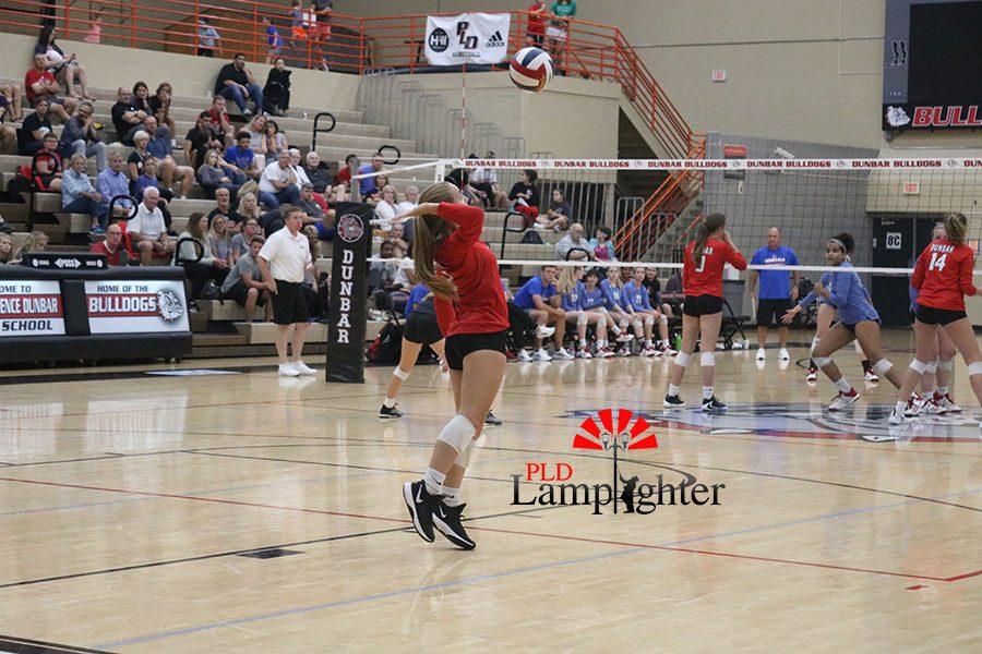 Senior, Lauren Spanyer, serves from the end line.