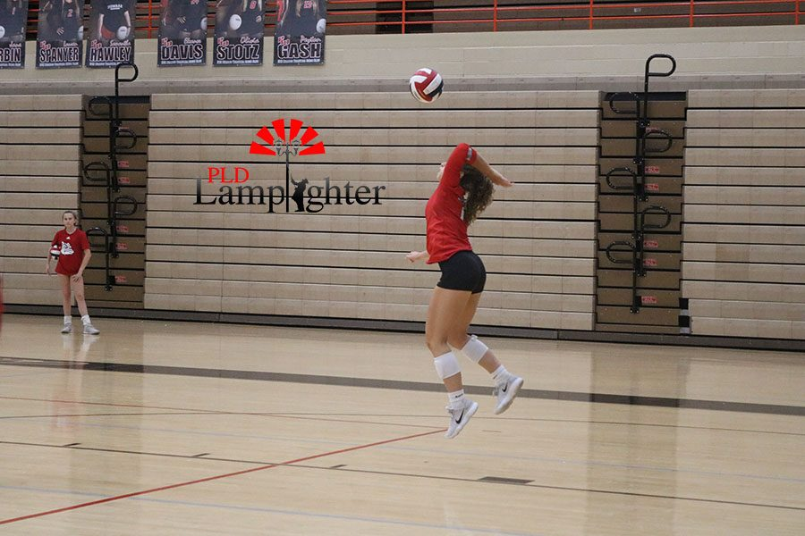 #1, Jane Durbin, serves from the end line.