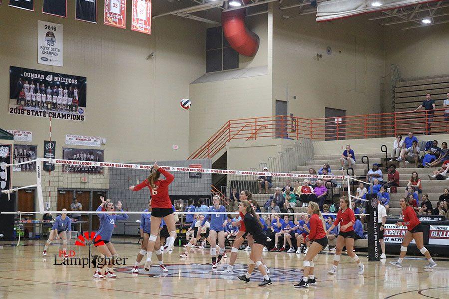 Junior, Kaetlin Ethington, reaches high to attack.