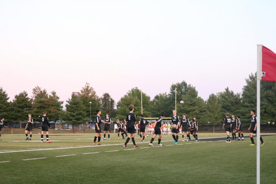 Varsity gets warmed up before the game against the Eagles.