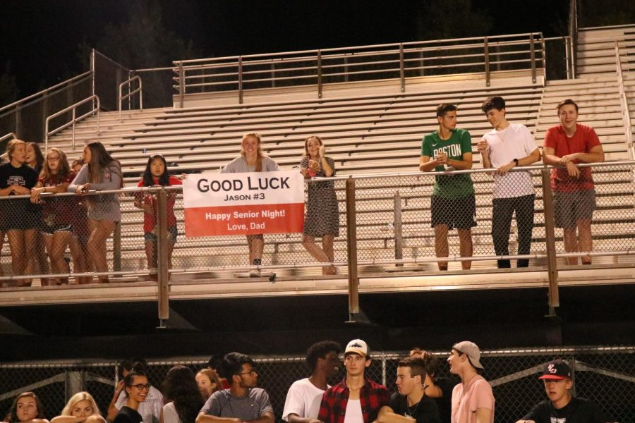 Students are seen with signs supporting the Dawgs on Senior Night.