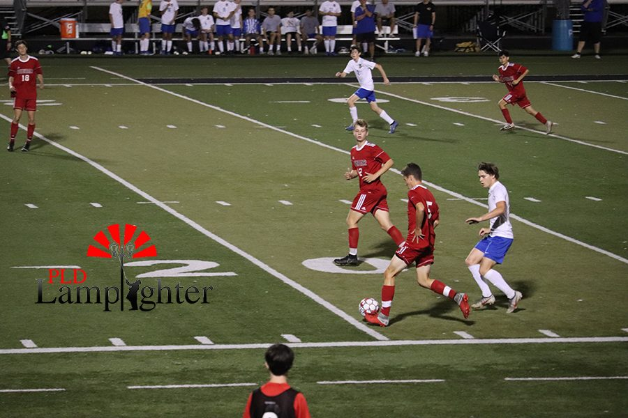 Bulldogs defend the ball as an opponent tries to gain possession.