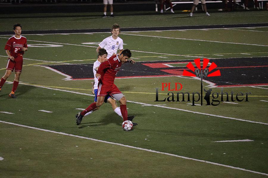 #17 Pablo Ortiz defends Dunbar's possession of the ball.