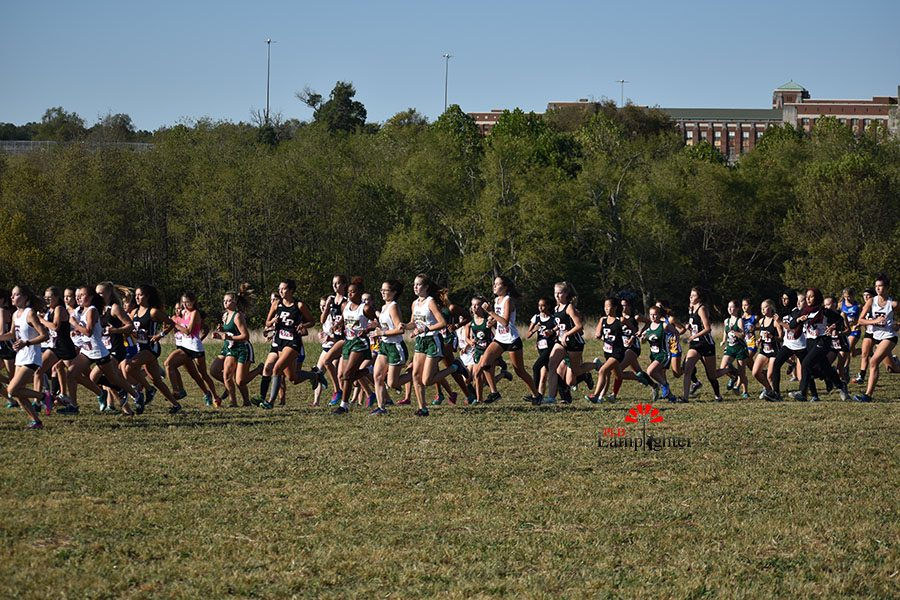 The push out of the starting line for the high school girls' race in which Dunbar ultimately finished second as a team.