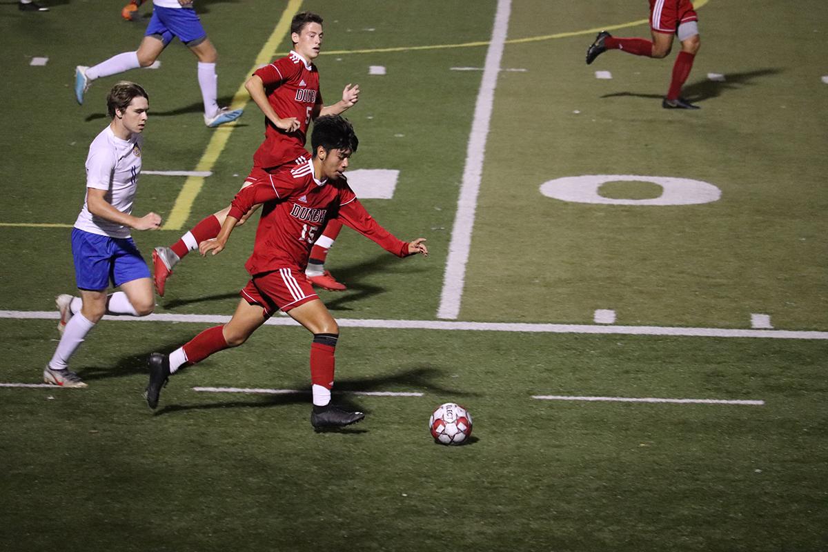 Defender Johnny Vazquez kicks the ball out of Newport Central Catholic's possession.
