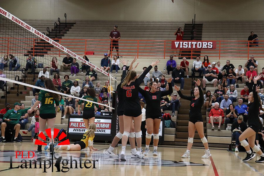 Bulldogs celebrate a point against the Bryan Station Defenders.