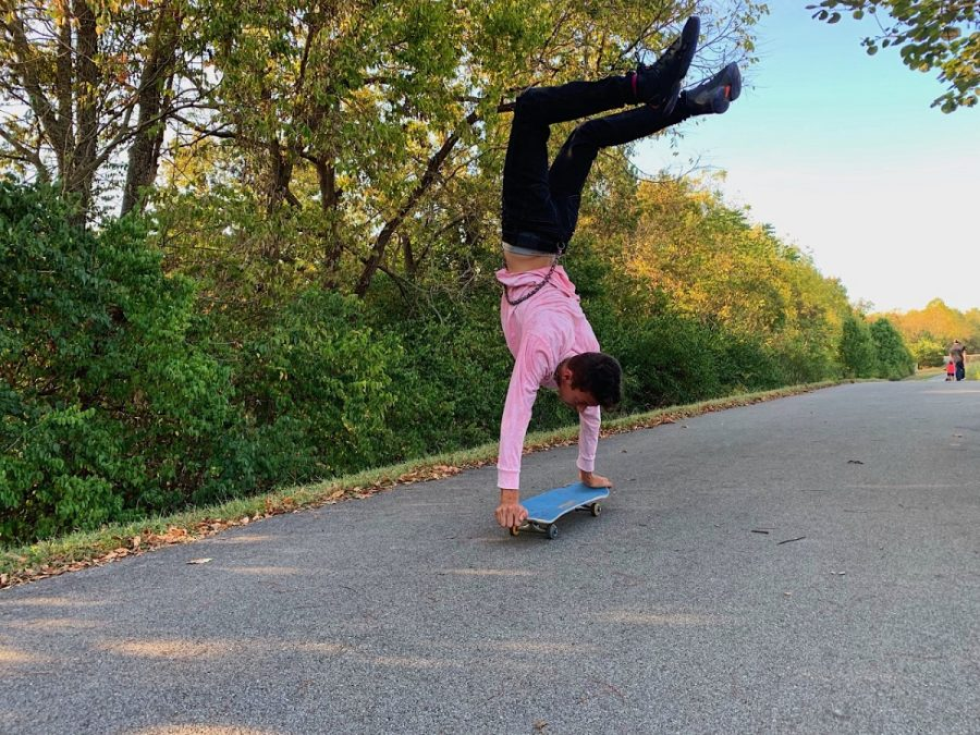 One of Alex's friend shredding up and down the streets while skateboarding.