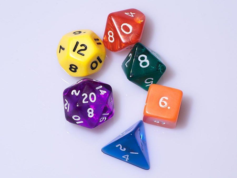 The typical D&D player carries a bag of signature 20-sided dice.