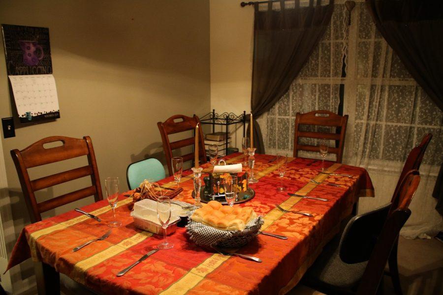 Friendsgiving table before it is set.