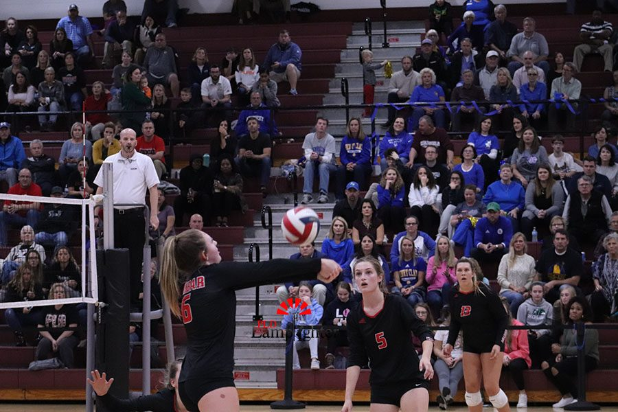 #6 Kaetlin Ethington hitting the ball back over to Henry Clay's side of the court on the 3rd hit to avoid giving Henry Clay a point