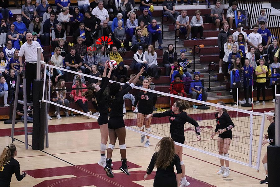 A Henry Clay player blocking a hit by #14 Eleanor Davis which allowed them to score a point