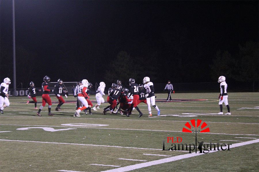 Dunbar makes an interception to gain possession of the ball.