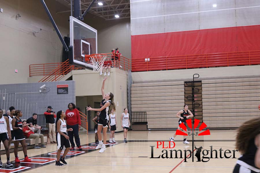 Bella Rusing, 8th grade, getting some air on her lay ups.