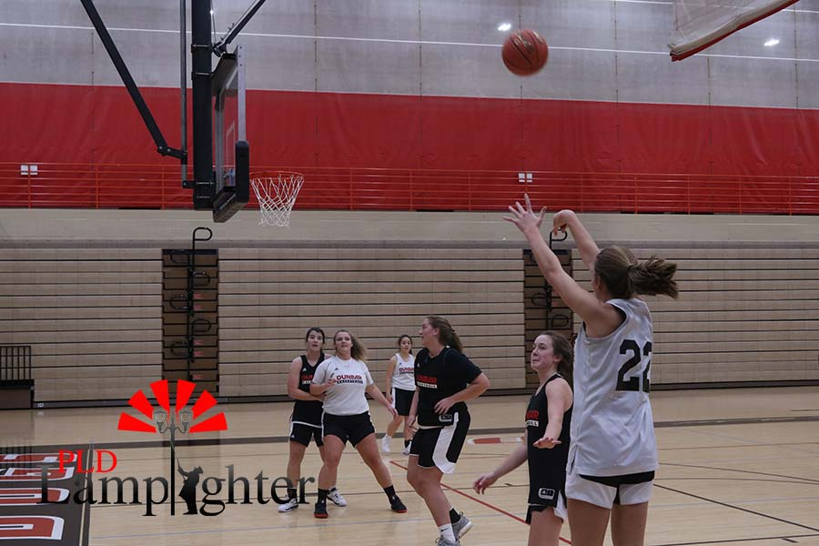 Maddie Ridge number 4, shoots from the three-point line, in a scrimmage.
