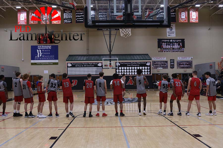 The boy's basketball team is introduced, before the practice and scrimmage.