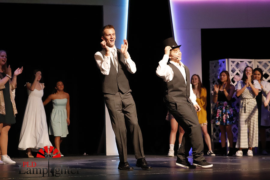 Mike (Darin Henshaw) and Fletcher (Jake Thomas) dancing during the finale.
