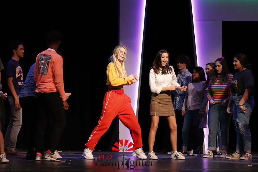 Savannah Scott and Lola Campbell (ensemble) show off their mirroring dance moves to the students.