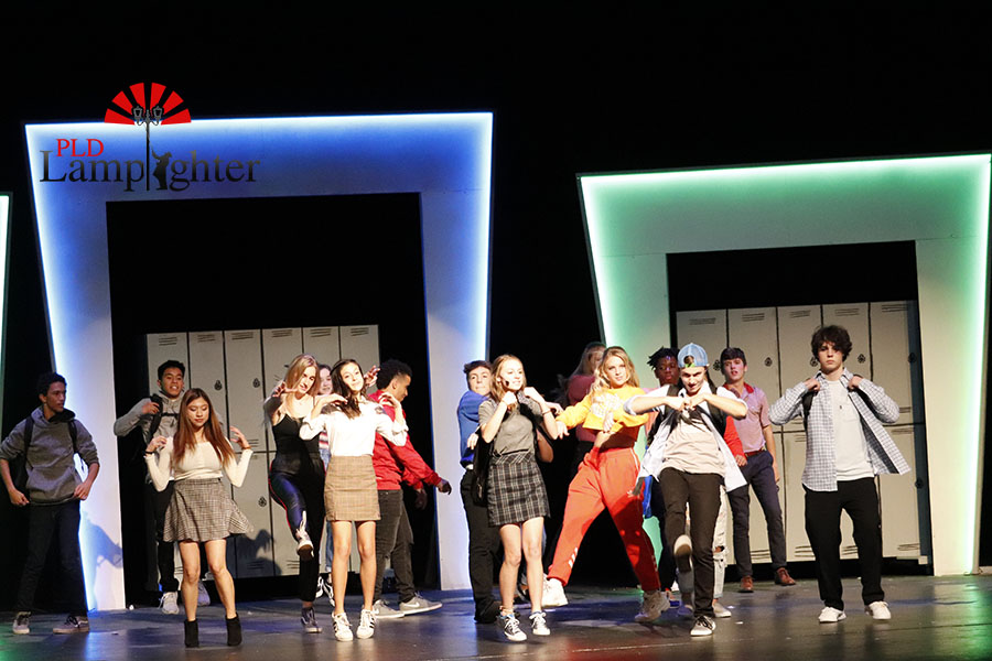 A group dance number at Ellie's high school to 'I got this'.