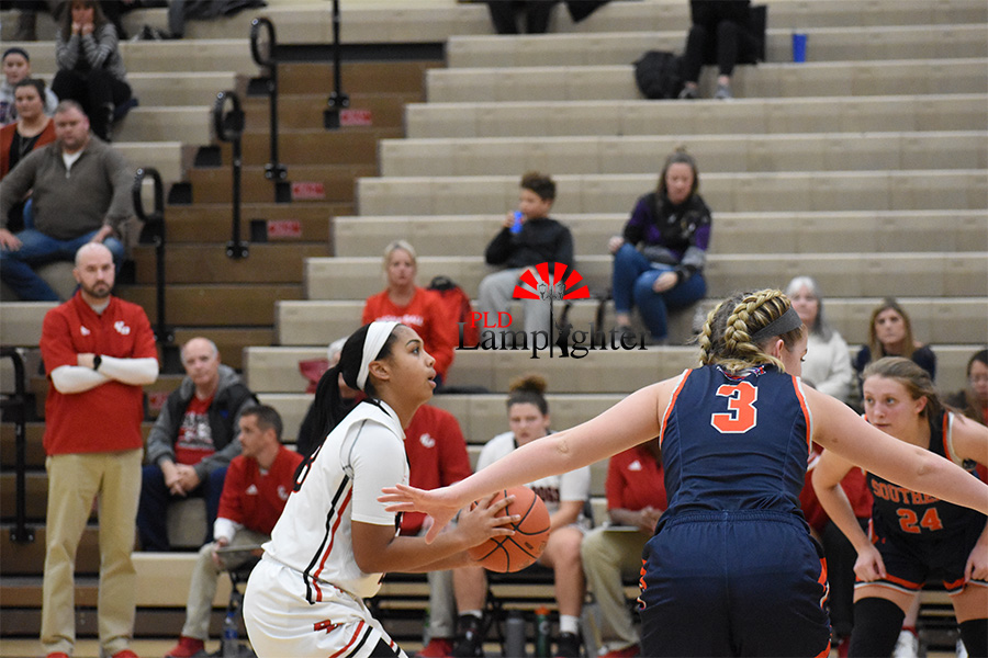 #23 shoots for a free throw to try and get a point for her team.