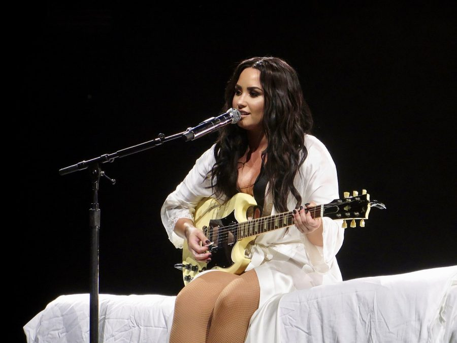 Demi Lovato performing during her