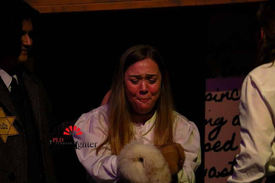 Mrs. Van Daan (Savanna Montgomery) is extremely upset that her fur coat is ruined  after Anne (Jaycee Castro) accidentally spilled milk all over it.