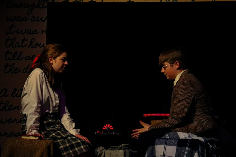 Anne (Jaycee Castro) introudces Mr. Dussel (Jake Thomas) to the room that they will be sharing during their time in the Annex.