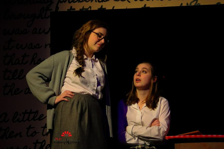 Margot (Lucy Nunnelley) gives her sister (Jaycee Castro) advice on how to act around her love interest Peter as she is about to go join him in the attic.