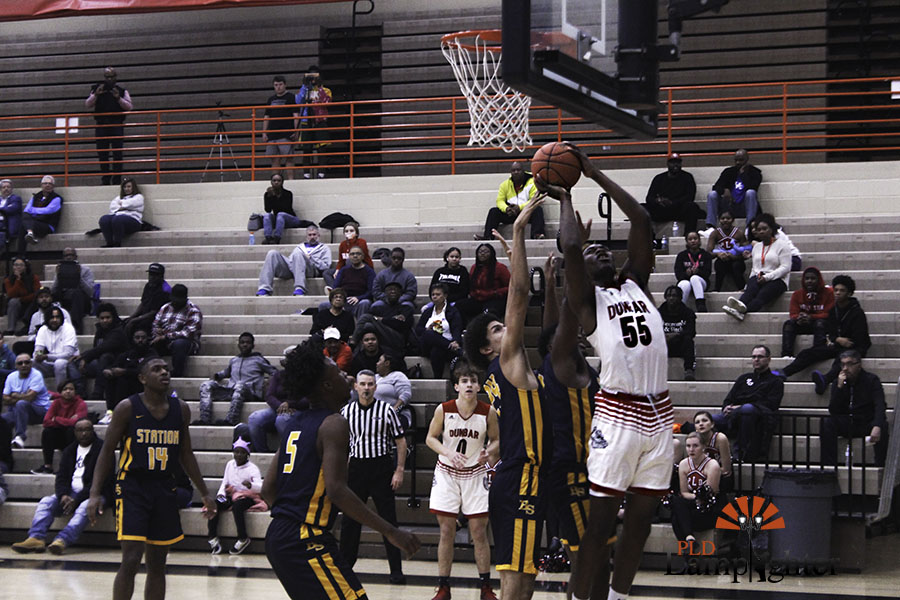 Number 55 posting up with a layup.