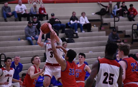 #31 Max VanDyke going up for a layup in the early stages of the game before having to sit fir the remainder of the game with an ankle injury.