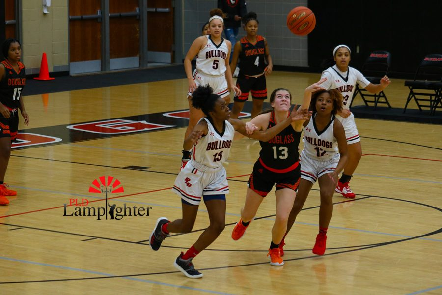 Aziah Campbell (#13) and DelTarria Jackson (#12) battle out for the ball.