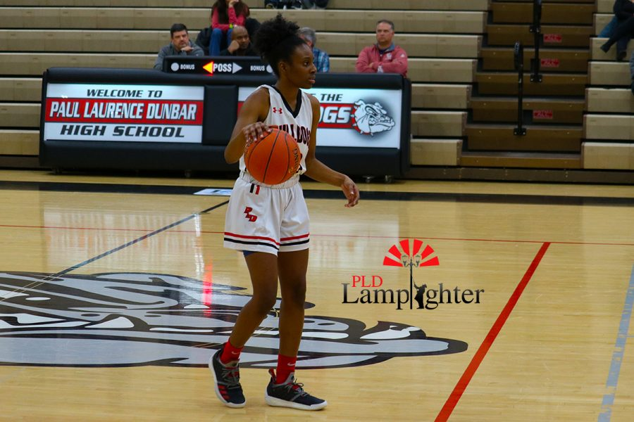 Aziah Campbell (#13) takes the ball down court to start the play.