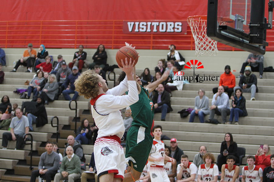 #34 Zach Carter goes up for  hard layup off of the fast-break.