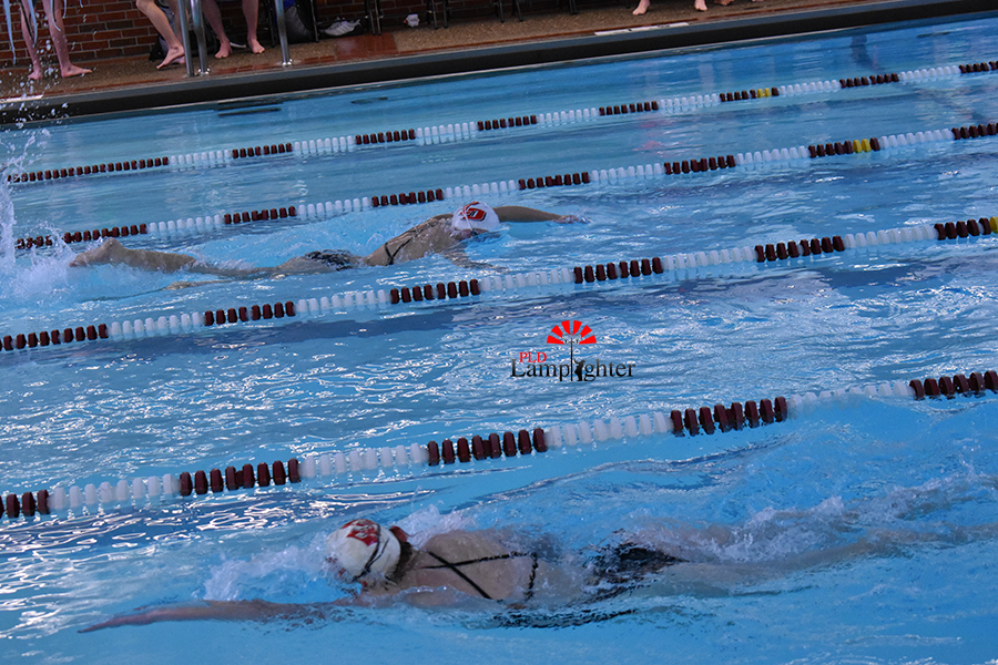 Dunbar competitors passing each other in separate lanes  in the freestyle.