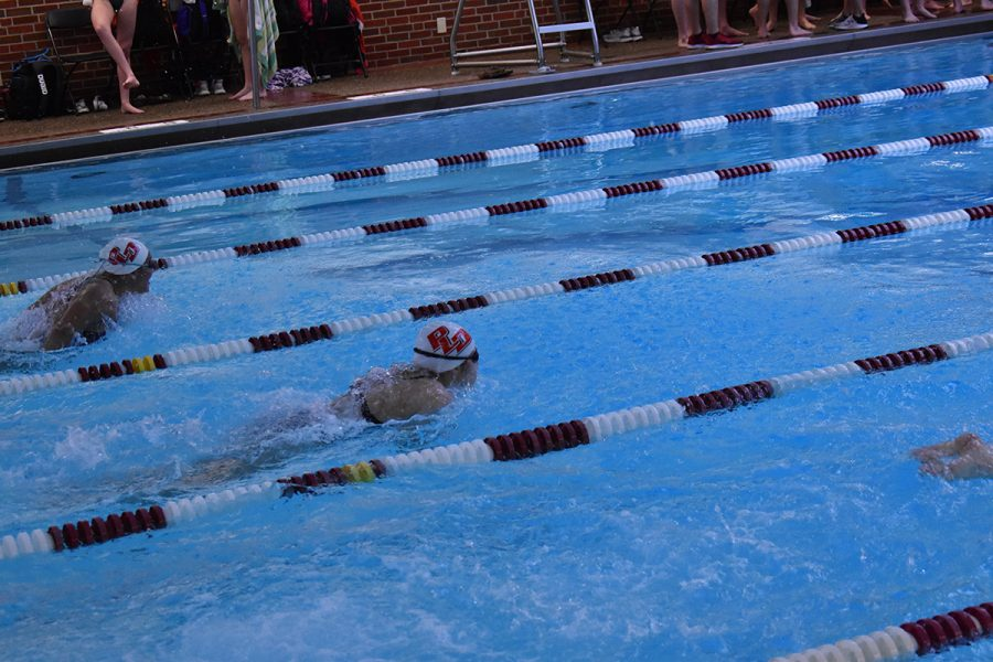Two Dunbar Girls Competitors in a class race down the stretch of the butterfly.