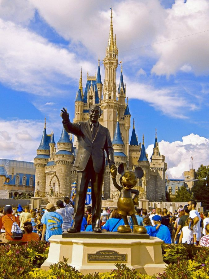 Walt Disney depicted in a statue with the iconic Mickey Mouse in Walt Disney World, Orlando Florida.